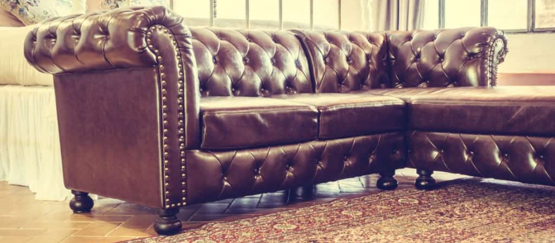 Vintage leather sofa decoration in livingroom interior - Vintage Filter
